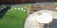 patio - Cobble Stone Patios in Rustic, with fresh sod and mulch perennial beds