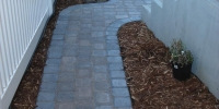 patio - Roman Euro Paving Stone Pathway in Rustic with a Charcoal Border and cedar mulch