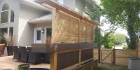 Horizontal cedar privacy screen added to the existing deck.