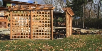 cedar privacy lattice with decorative arbor