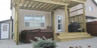 tiered pressure treated pergola with decorative double beams