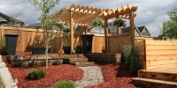 cedar pergola and privacy lattice with arbor