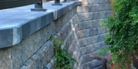 retaining wall - rustic roman pisa retaining wall with charcoal capstones