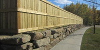 retaining wall - sandstone slab retaining wall with pressure treated fortress style fence