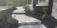 steps - rundle stone slab step with exposed aggregate pathway