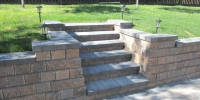 steps - rustic pisa II retaining wall and steps with charcoal capstones