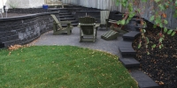 steps - charcoal pisa II and revers a cap steps and retaining wall with cobblestone patio