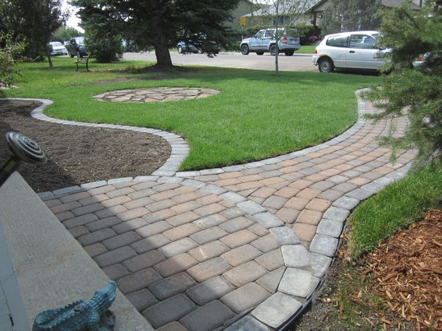 Landscaping Bricks Calgary : Front door pathway and mow brick around bed using rustic cobble pavers