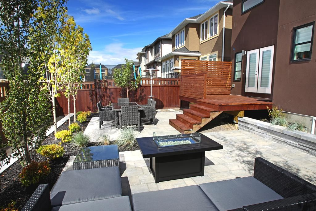 Outdoor Rooms, Cedar deck, privacy lattice, paving stone patio, retaining wall