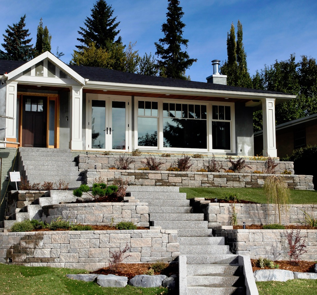 Allan Block Retaining Wall built in Calgary creates a visually appealing and usable terraced front yard.
