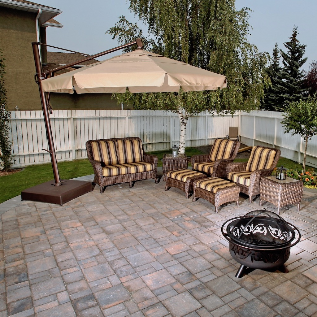 Calgary Patio done in Rocky Mountain pattern pavers in Rustic with outdoor furniture and firepit